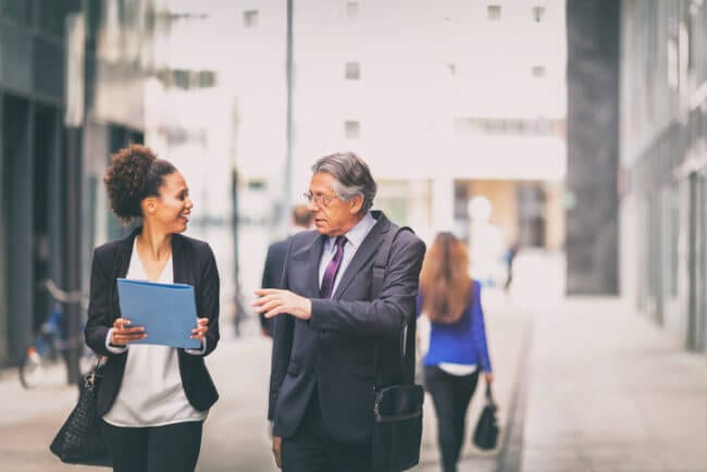 retiree helps younger employee retain institutional knowledge