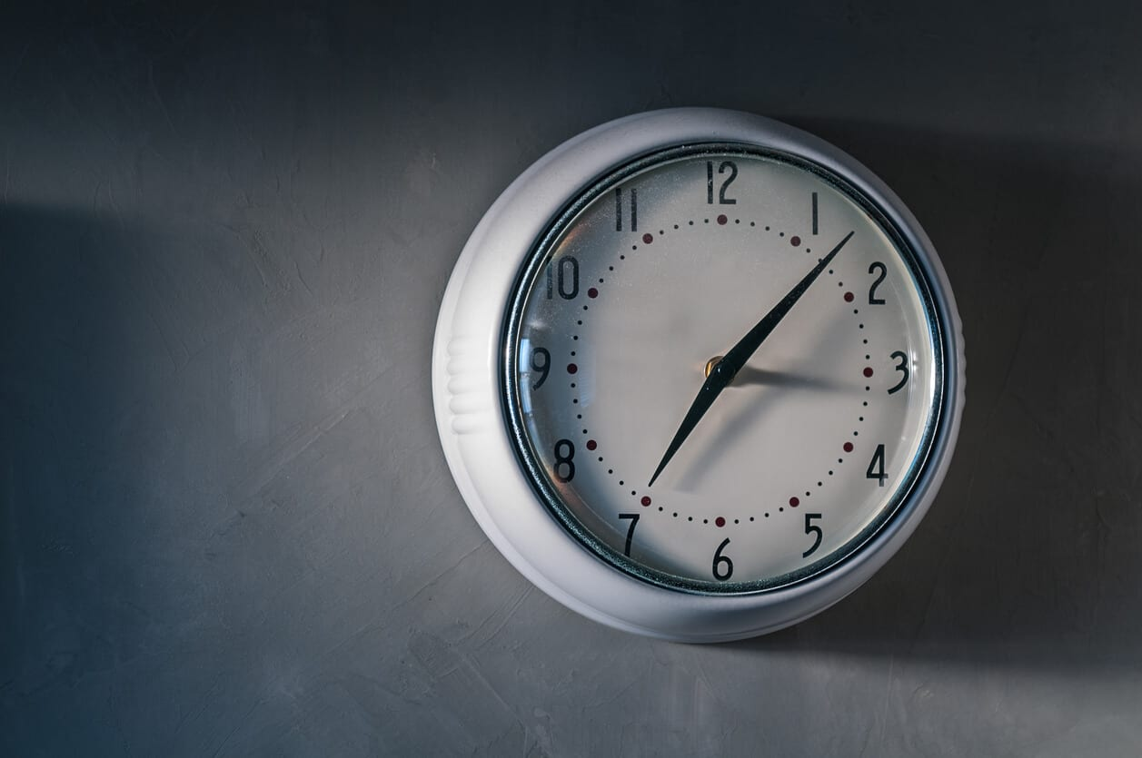 clock on wall in office representing use of knowledge worker time