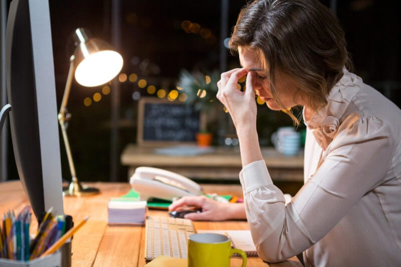 stressed businesswoman working late showing challenges in sales