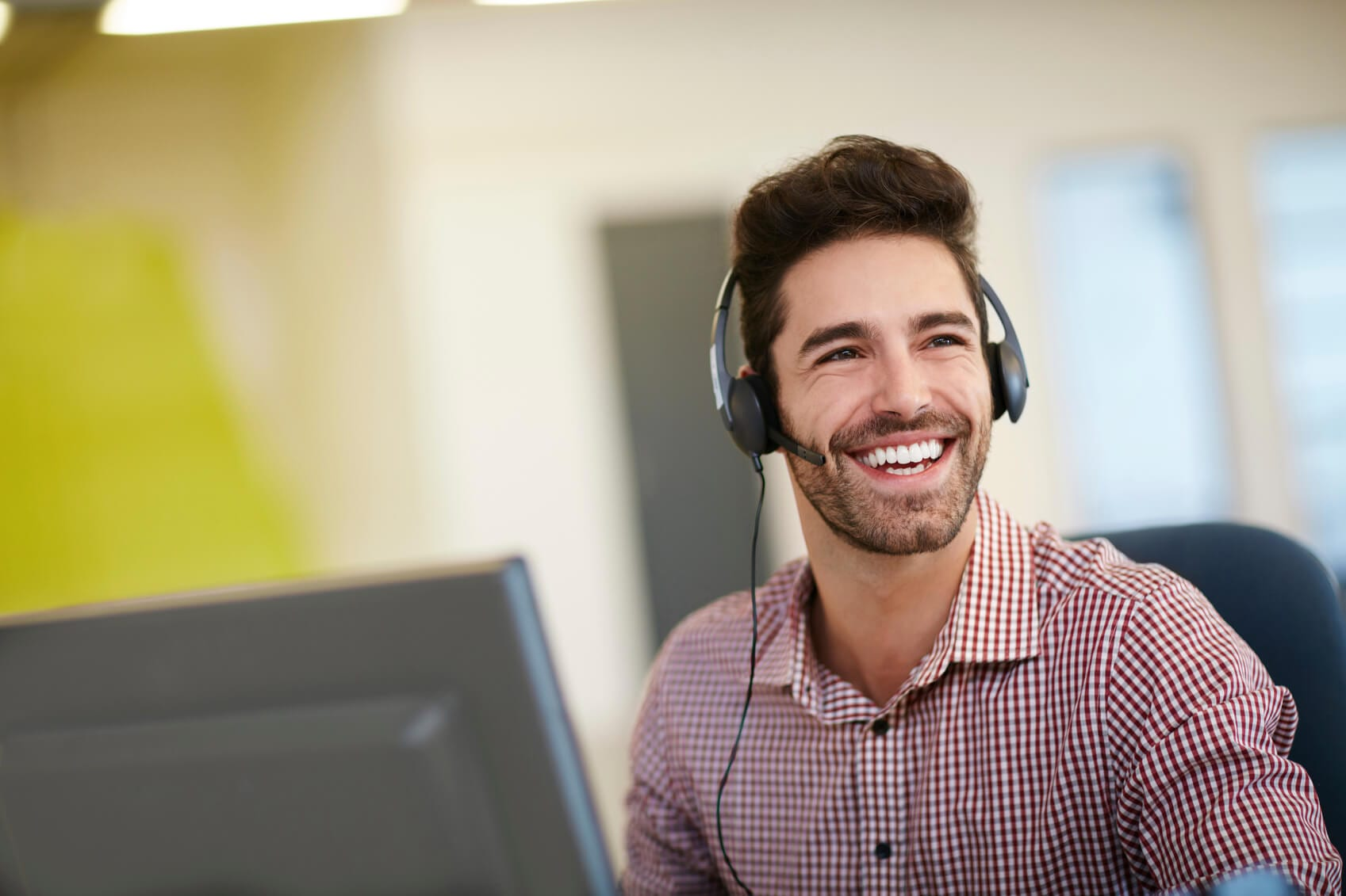 Happy customer support specialist providing excellent customer service.