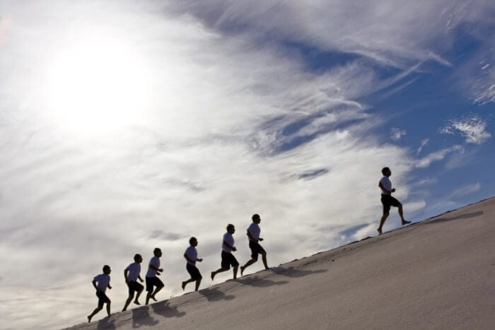 silhouettes of runners represent driving digital transformation