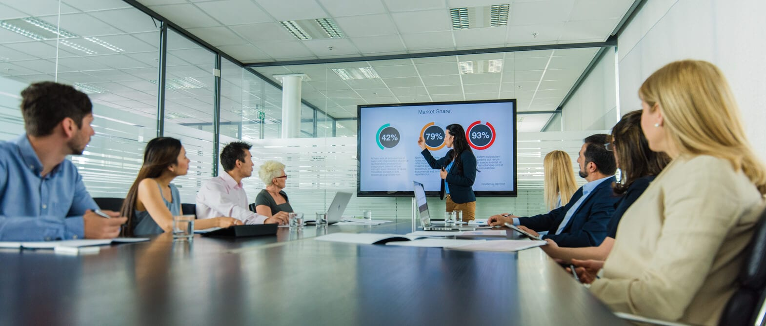 businesswoman gives presentation on reducing lost productivity with knowledge management