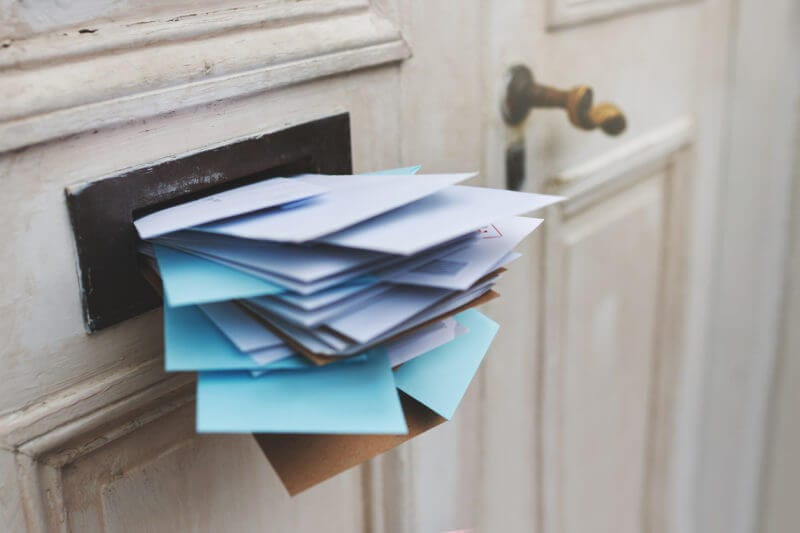 stuffed mail slot representing email overload