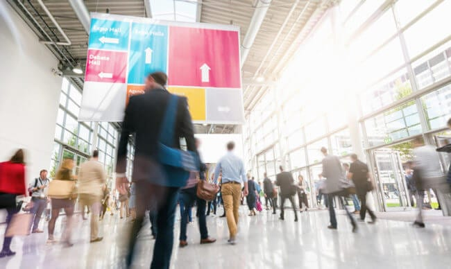 industry conference foyer depicts one strategy for monitoring customer trends