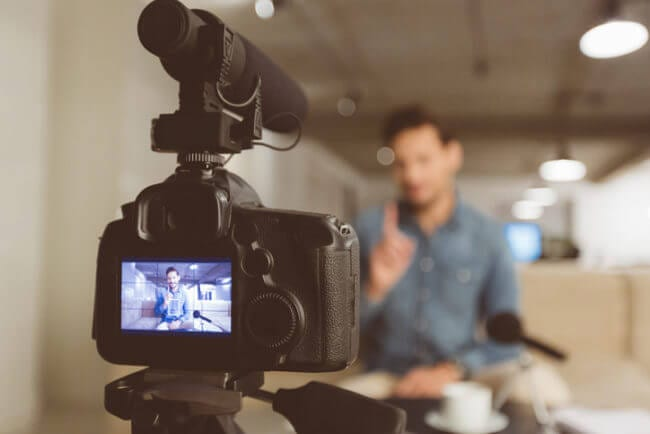 man recording knowledge base videos in office