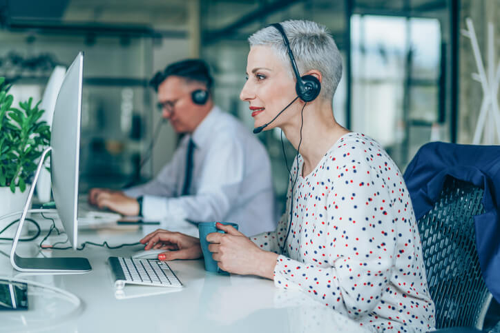 two call center employees use knowledge sharing tech as part of customer service strategy