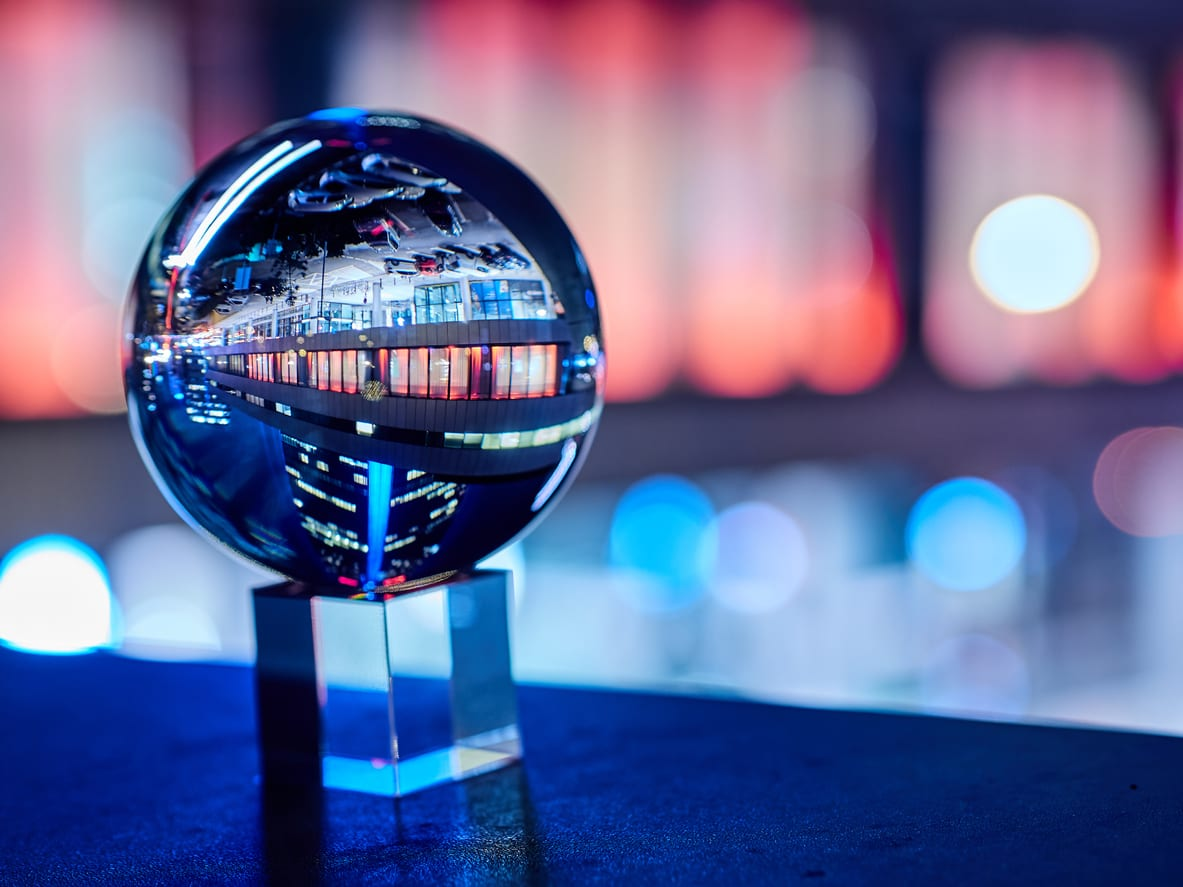 crystal ball with city backdrop represents market research trends