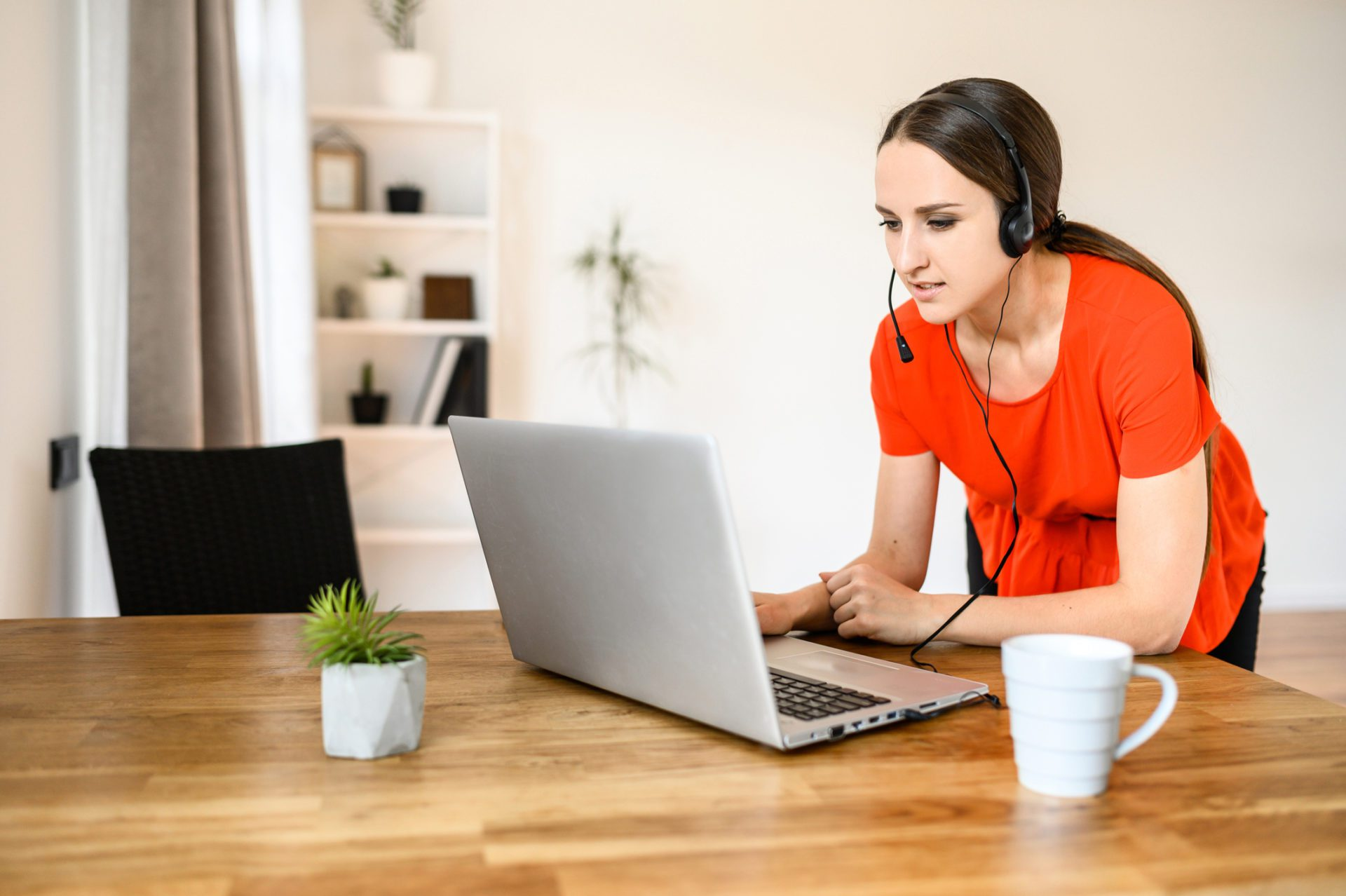 customer service agent stands at table while working remotely