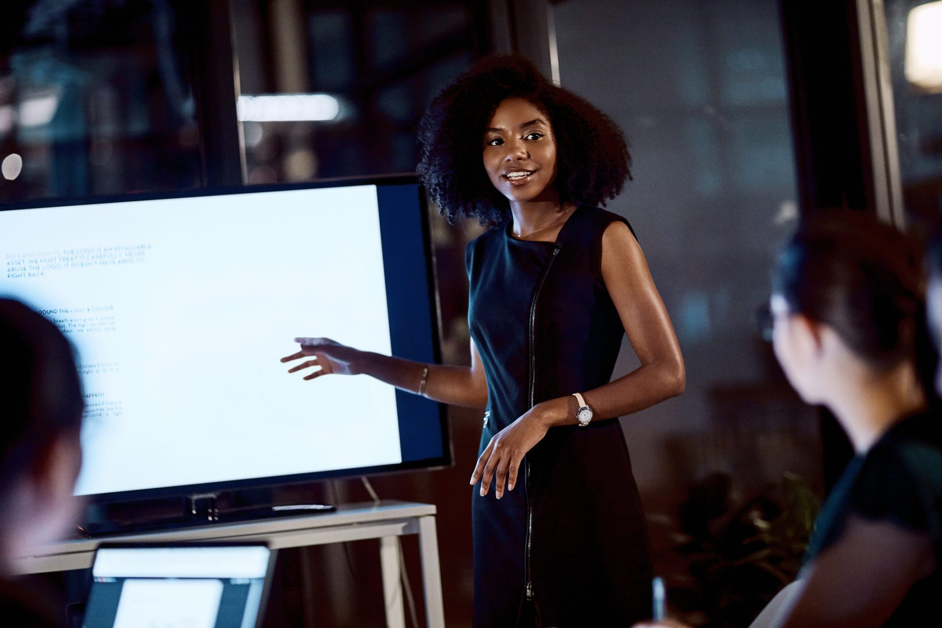 businesswoman gives presentation on market researchers digital transformation