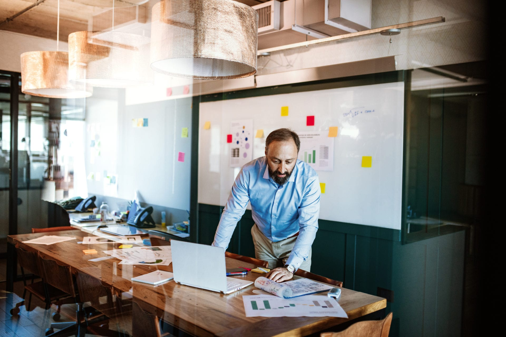 businessman in modern office space developing market research skills