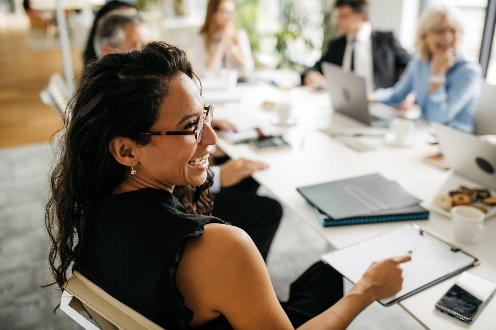 smiling insights team leader in company with great EX